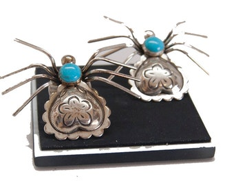 Two spider pins with turquoise stones