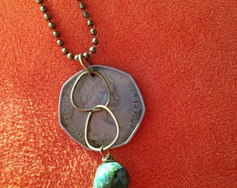 Resin Foreign Coin with tourquoise colored bead on brass ball chain
