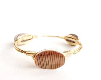 The Audrina | gold bangle with striped shells