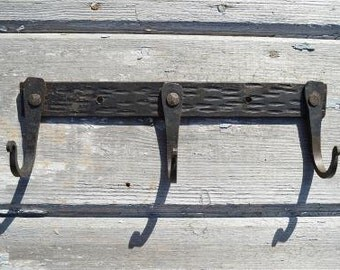 A beautiful hand wrought iron medieval 3 hook rack M2