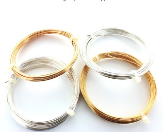 Gold or silver plated wire on copper.  Price is for 1 reel