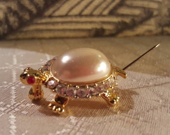 Vintage Faux Pearl Turtle brooch with red rhinestone eyes, and clear rhinestone around