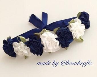 Navy and white flower bun wreath