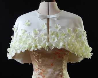 Short Cape Capelet in Ivory Duchess satin with sewn on artificial flowers. Exclusive