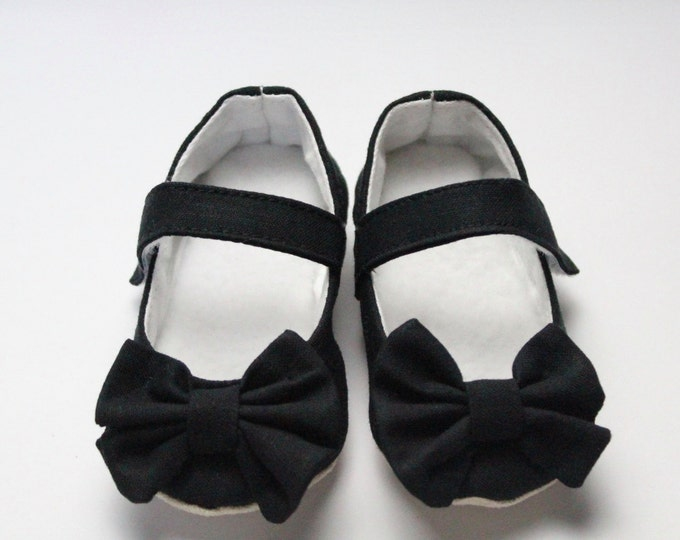 Black Mary Jane soft sole baby girl shoes, with over sized bow