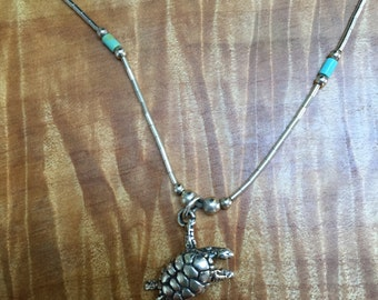 Liquid sterling necklace with turtle