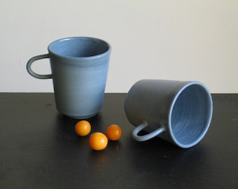 Coffee Cup. Ceramic Cup. Pottery tinted in the mass. Blue Cup. Cup with a handle. Tinted sandstone.