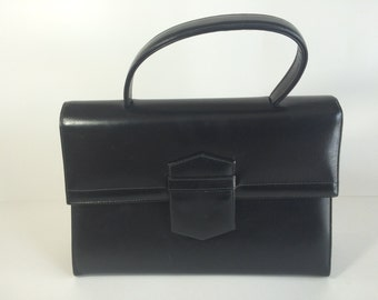 Elegant 50s Art Deco Kelly Style Handbag in Black Leather by Coret Accessories Inc., of Montreal, Canada