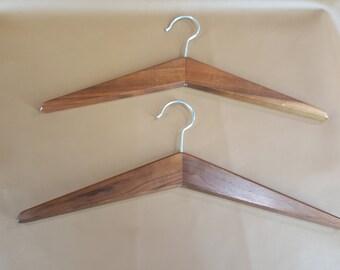 Pair of mid century minimalist walnut hangers