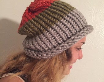 gray, green, and orange knit hat