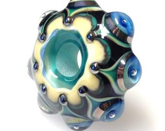 A Handmade Glass Bead, Mandala Style Glass Bead, Blue, Green, Ivory and Black