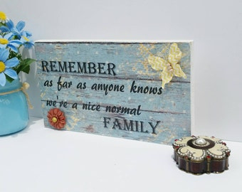 Remember as far as anyone knows, we're a nice normal family sign, wooden sign, family  sign, silly sign