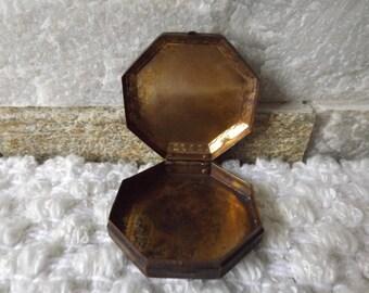 Copper coloured vintage pill box