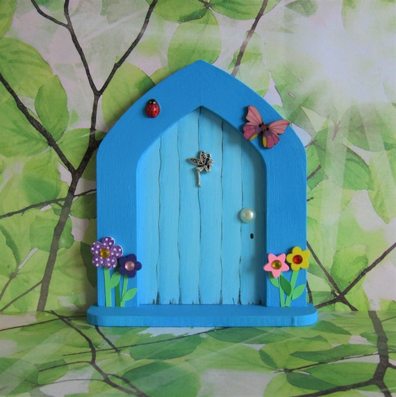 Blue fairy door with magic dust and key by for Fairy door with key