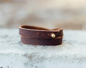women's customizable wrap bracelet in brown // hand-cut oiled, brown kodiak leather with a gold push through fastening system // simple and