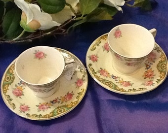 A pair of 1930's vintage coffee cups and saucers
