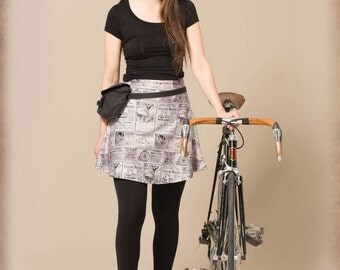 Black and White Newspaper Skirt. Vintage Bike Advertising Collage.