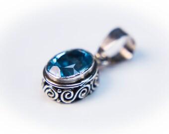 Oval-Cut Blue Topaz Pendant