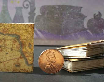 Miniature books with antique map covers