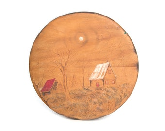 Vintage engraving wood round frame. Home decor. Wall decor. Two old houses in the forest.