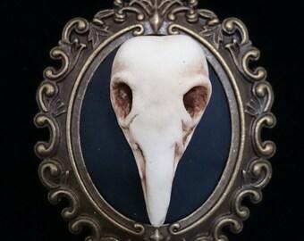Creepy bird skull cameo necklace