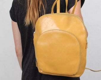 Vintage 1990s yellow leather backpack / rucksack