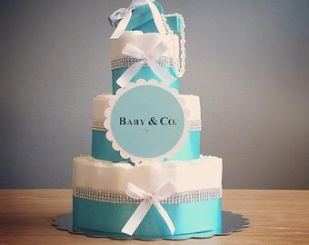 baby co diaper cake with blue gift box pearls and a baby and co die