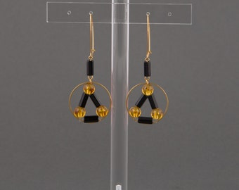 """Ring creole earrings.Round, yellow, amber,black tube beads.Earrings with triangle.""""Pythagore"""""""