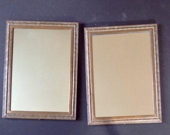 Antique Pair of solid bronze mirrors