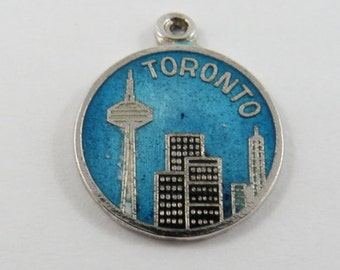 Skyline of Toronto With Enameled Blue Sky Sterling Silver Charm or Pendant.Slightly Impaired with Small drop of Silver and wax on back.