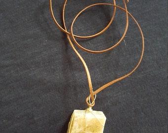 Beautiful Calcite stone pendant on leather cord