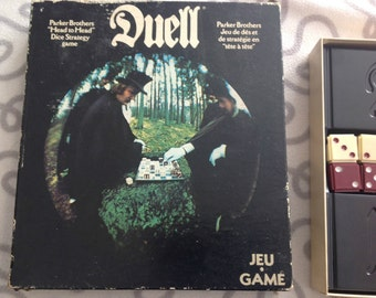 1976 Parker Brothers DUELL dice game.  100% Complete! w/original instructions.  Bilingual (Eng/French) Canadian version.