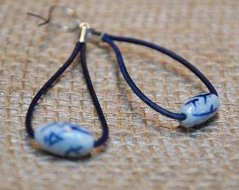 Long leather porcelain earrings