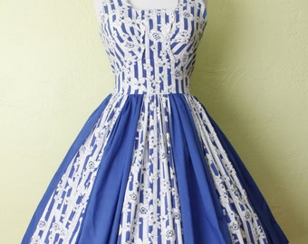 1950s Style Dress- Circle Swing Skirt- Harlequin Blue Color Block and Flower Print