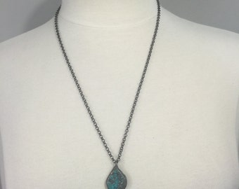 Gunmetal rolo chain with a soldered Turquoise stone pendant