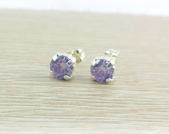 Sterling Silver set with a lilac cubic zirconia Stud Earrings