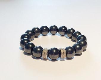 Hematite gemstone bracelet with 0.88 carat pave diamond