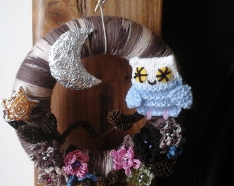 Wreath with an owl and flowers, cones