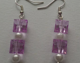 Handmade earrings with light purple plastic beads, with faux pearl accent beads