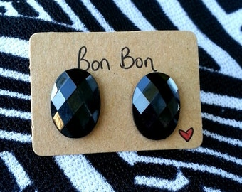Black oval stud earring