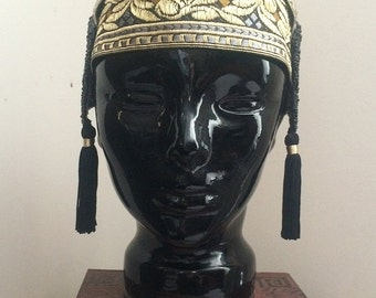 1920's style headpiece in gold silver and black