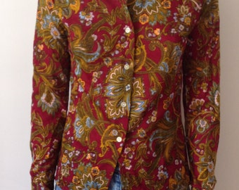 vintage floral paisley blouse on a burgundy background 70s hippy