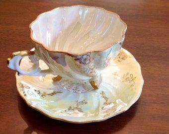 Lustre ware teacup and saucer
