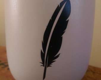 Tealight holder with feather decal