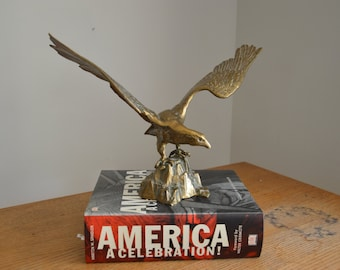 "Large vintage brass eagle on rocks figurine. 15.75"" wide and 11"" tall"