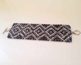 Glamorous Fire Polish Czech Crystal woven cuff bracelet. Chevron pattern/ sterling plated toggle clasp.