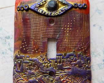 Urban Eye of Protection, polymer clay, switch plate cover, abstract, reds, purples, gold, maroon