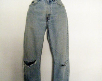 orange tab LEVIS 505 boyfriend jeans, straight leg cut, naturally distressed with rips and holes, size 31 x 32