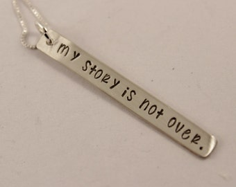 My story is not over - Tiny, custom hand stamped sterling silver necklace