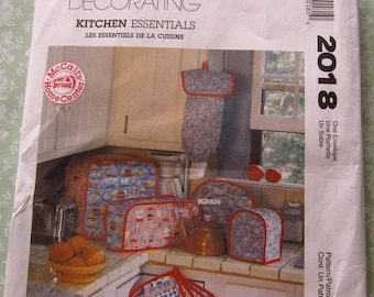 Kitchen Essentials Sewing Pattern: Appliance Covers, Chair Cushions, Bag Holder, Pot Holder, Tea Cozy, Napkin McCalls Pattern 2018 UNCUT